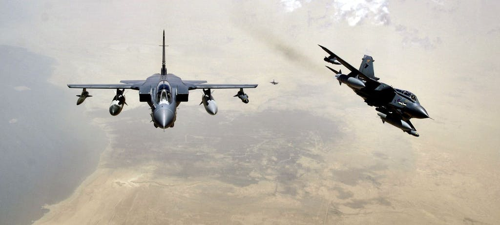 Two RAF Tornado GR-4s pull away from a KC-135 Stratotanker after refueling. (U.S. Air Force photo/Master Sgt. Lance Cheung)