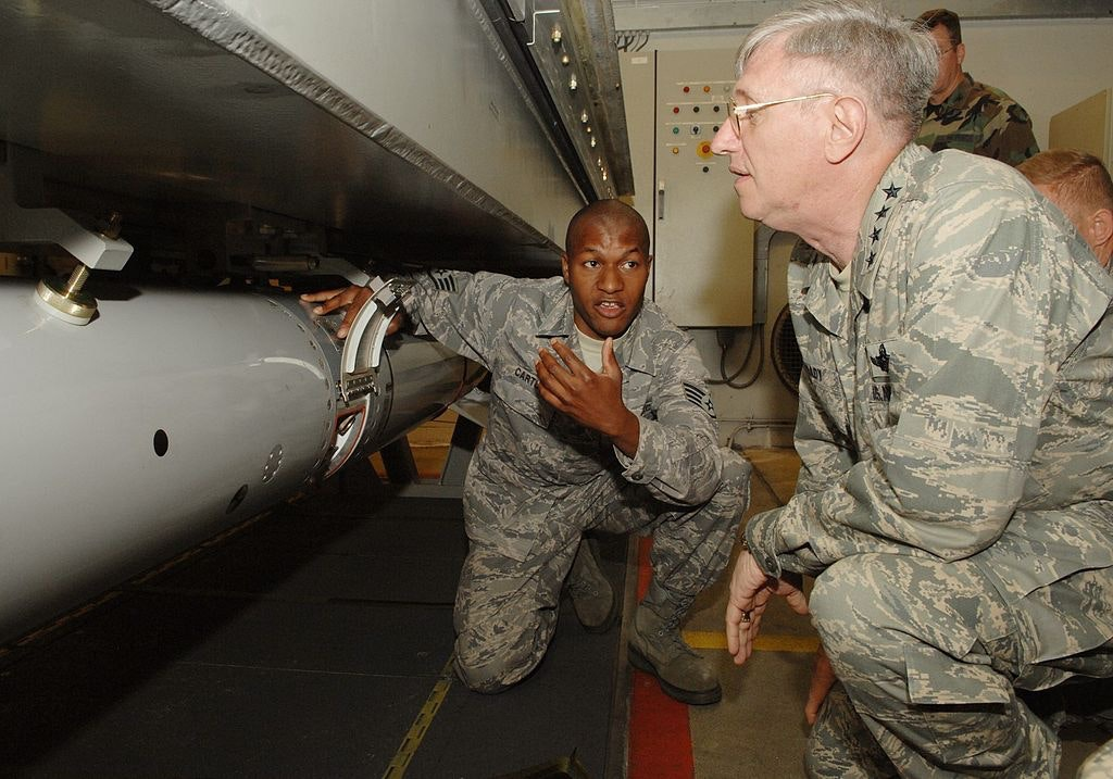 """General Roger Brady, USAFE Commander, is shown B61 nuclear weapon disarming procedures on a """"dummy"""" (inert training version) in an underground Weapons Security and Storage System (WS3) vault at Volkel Air Base, The Netherlands, on June 11, 2008."""