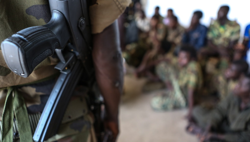 A soldier stands guard over children rescued from a militant group in CAR. Credit: © UNICEF / Matas