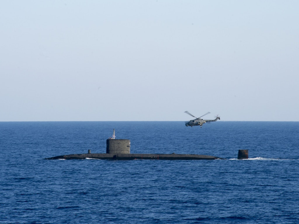 HMS Talent with a Lynx helicopter in the Mediterranean Sea.