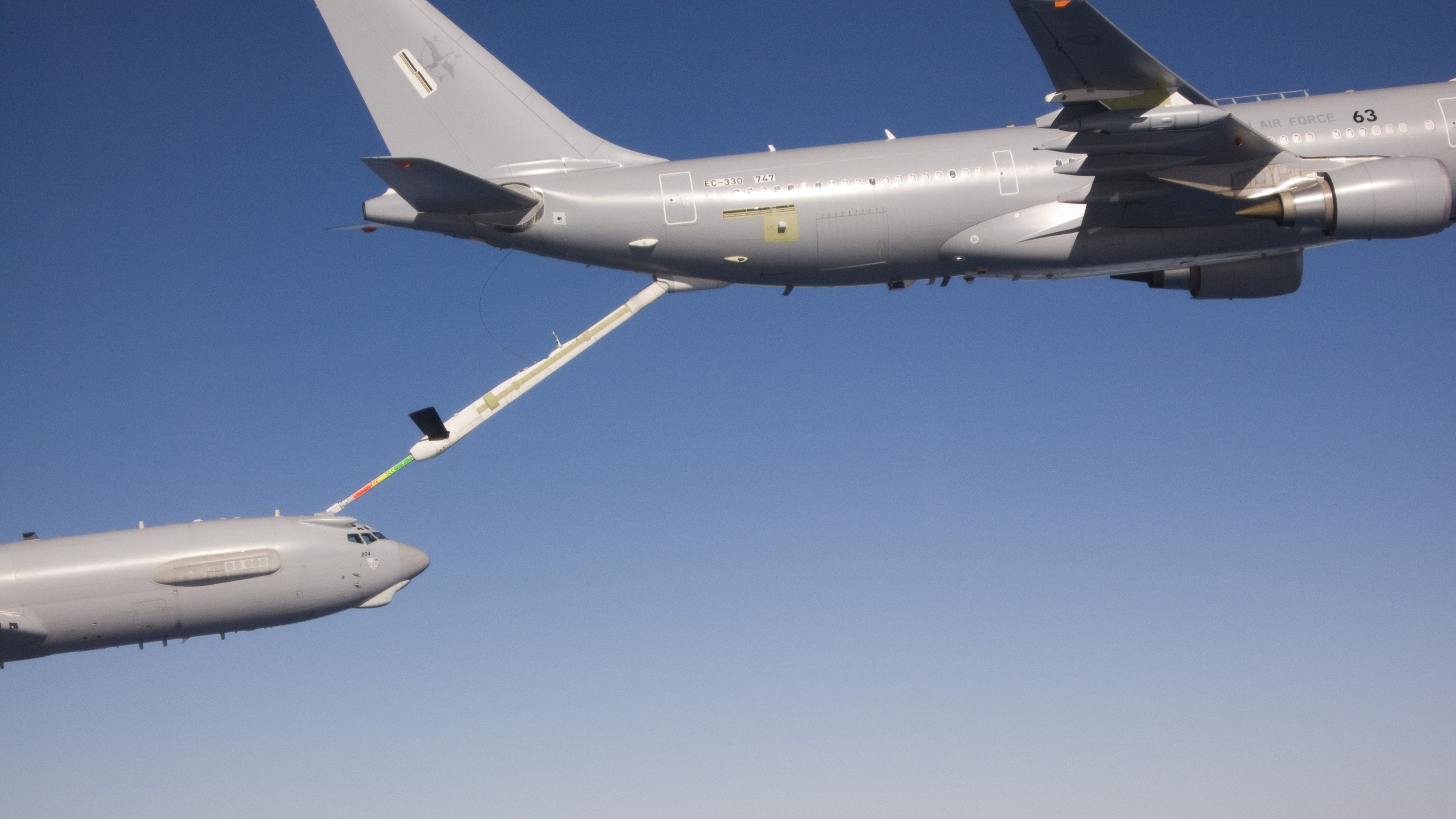 An Australian tanker, the same type of aircraft as Voyager, using its boom to refuel an aircraft.