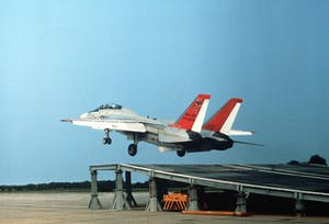 1280px-F-14A_taking_off_from_a_ramp_during_ski_jump_feasibility_tests.jpg