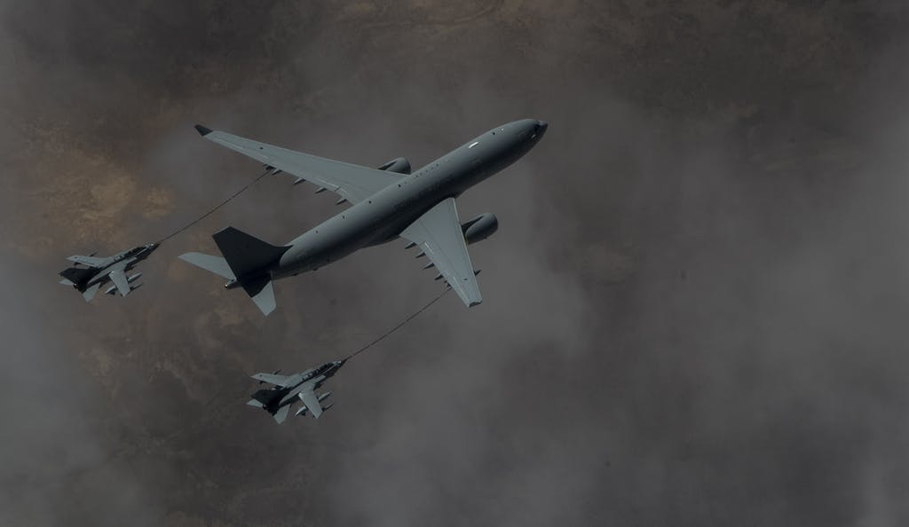 A Royal Air Force Voyager KC2 refuels two RAF Tornado GR4, March 4, 2015, over Iraq. The RAF aircraft provide combat air support for the coalition against Da'esh. (U.S. Air Force photo by Staff Sgt. Perry Aston/RELEASED)