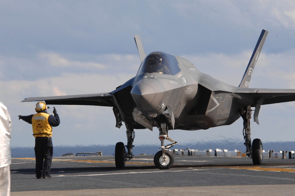 An aviation boatswain's mate directs an F-35B aboard the amphibious assault ship USS Wasp (LHD 1). (U.S. Navy photo by Mass Communication Specialist 1st Class Justin K. Thomas/Released)