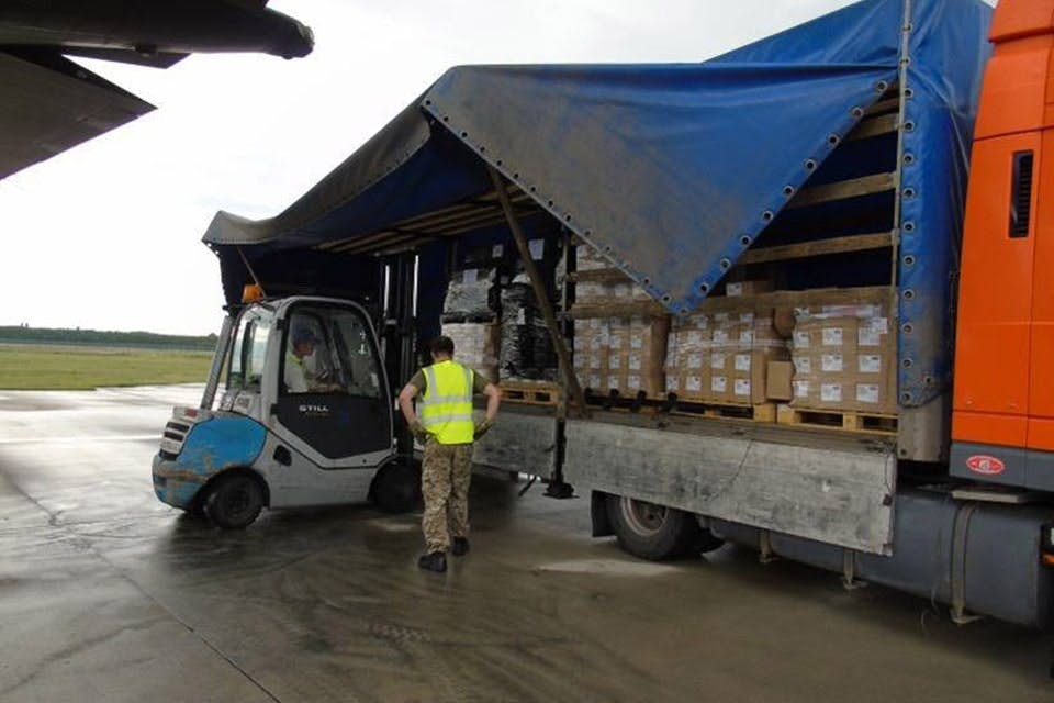 The equipment supplied by the UK is loaded for delivery to Ukrainian troops fighting Russian-backed separatist forces in the east of the country.