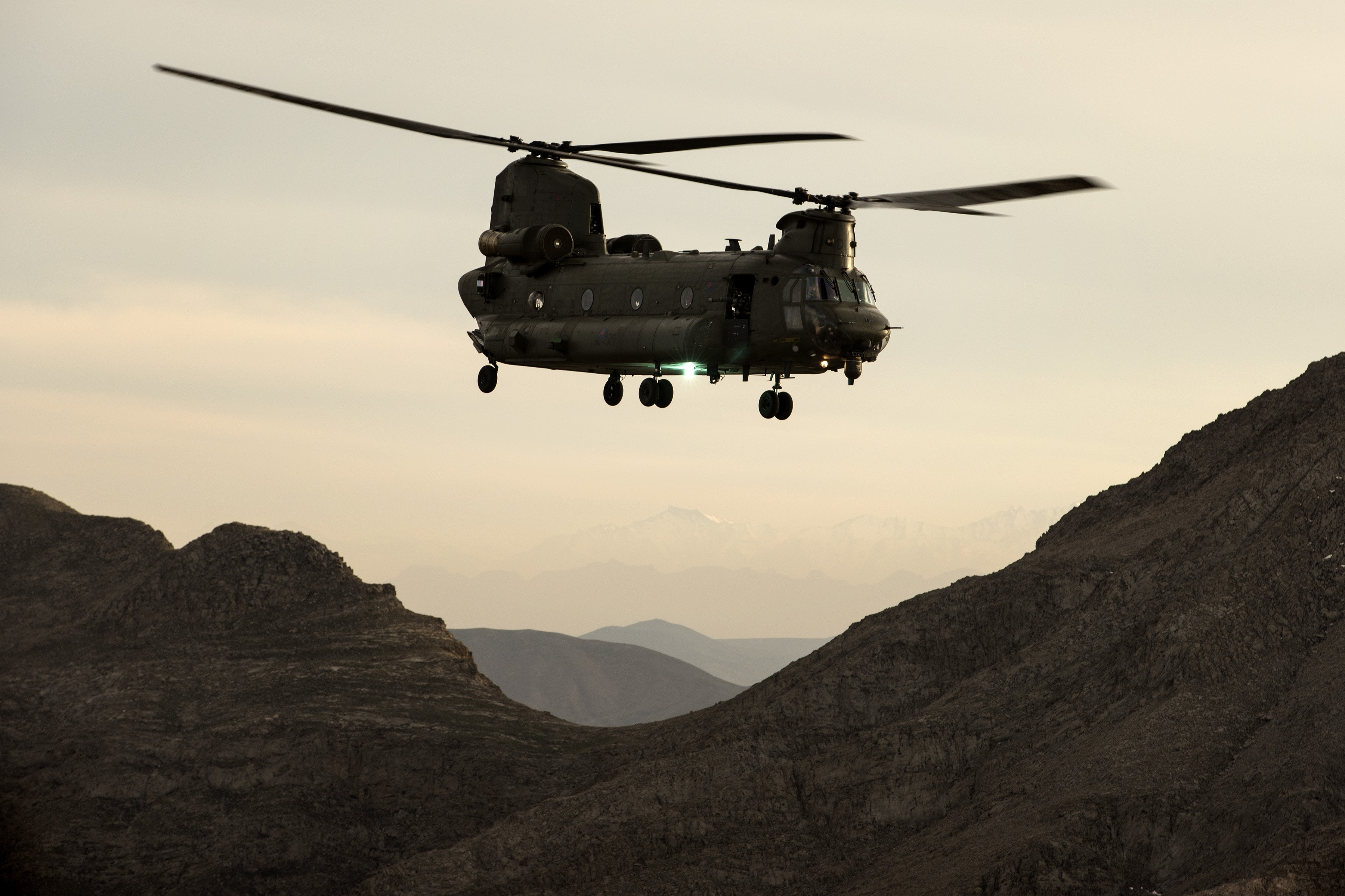 An RAF Chinook helicopter flying over the mountains of Afghanistan. Synonymous with operations in Afghanistan over the last thirteen years, the Chinook Force flew over 41,000 hours, extracted 13,000 casualties and its crews have been awarded numerous gallantry awards, including twenty three distinguished flying crosses for bravery in the air.