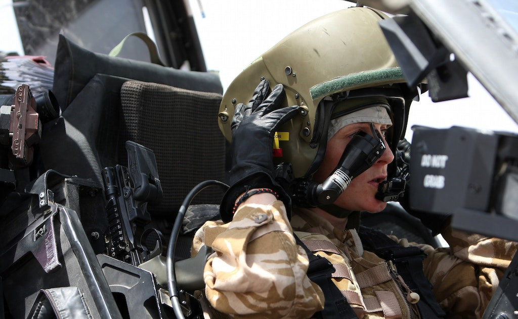 A female Apache helicopter pilot of 656 Squadron, 4 Regiment Army Air Corps prepares for a sortie from Camp Bastion, Helmand Province, Afghanistan.