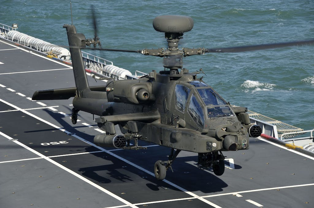 An Army Air Corps Apache attack helicopter takes off from the deck of HMS Ocean. (Open Government License)