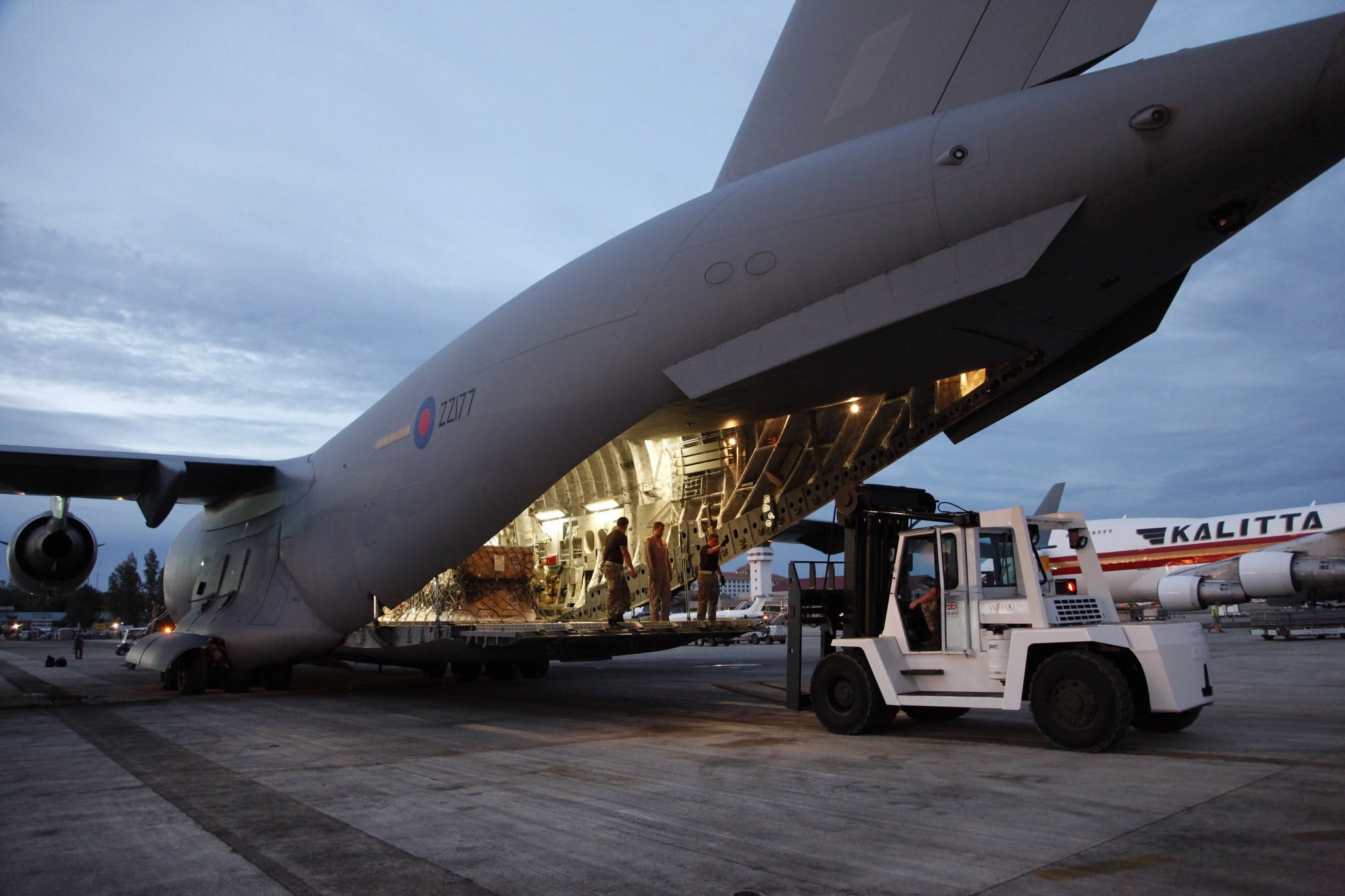 British humanitarian aid is unloaded from an RAF C-17.
