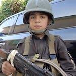 Wasil Ahmad wearing a kevlar helmet and uniform