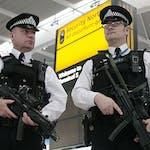 British armed police patrol the new Terminal 5 at London Heathrow