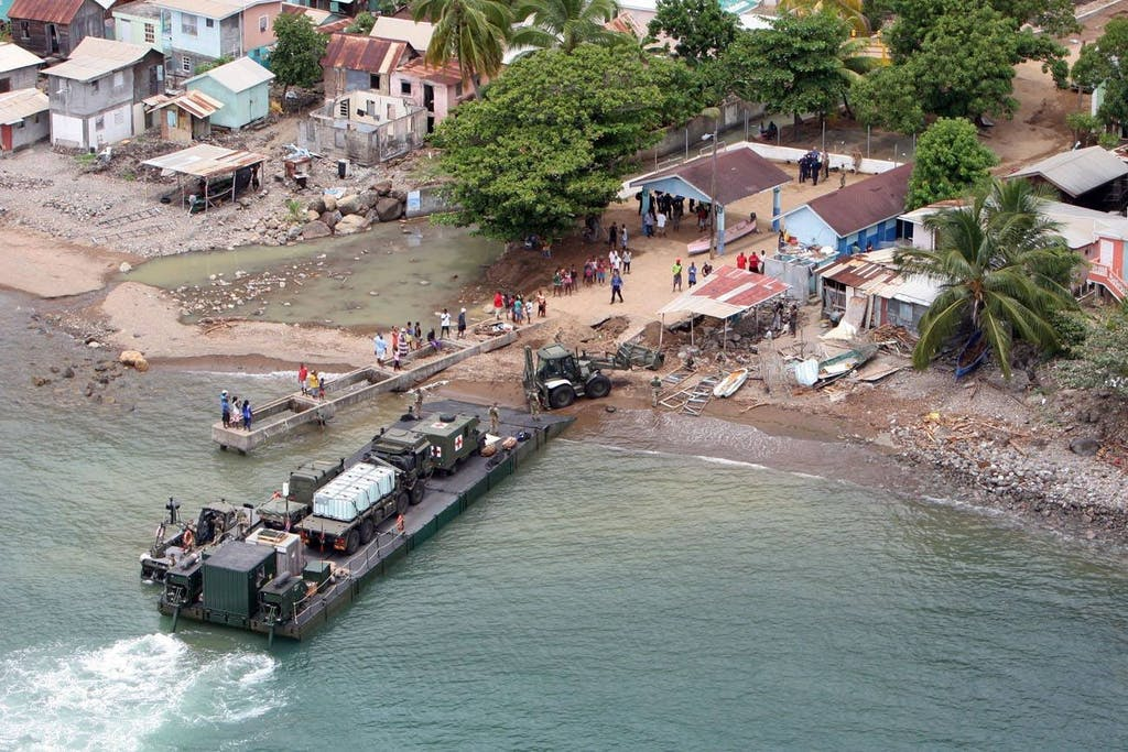 A Royal Logistic Corps craft lands Humanitarian and Disaster Relief (HADR) Troop ashore. (OGL)