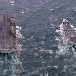 DOUBLE FIRST FOR NAVAL SERVICE AS HMS QUEEN ELIZABETH AND RFA TIDESPRING MEET UP AT SEA