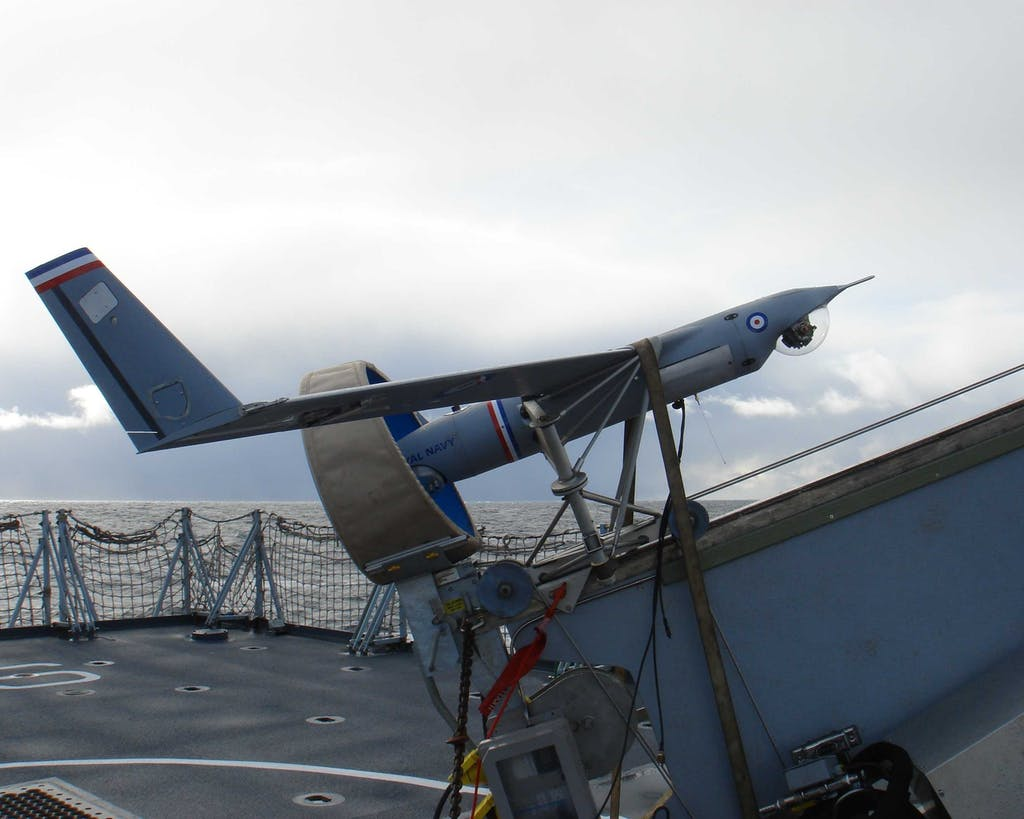 Royal Navy ScanEagle on its launcher in preparation for take-off from a frigate.