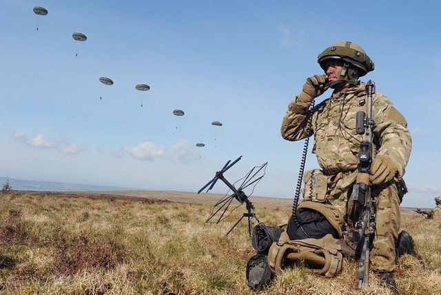 Forward Controller coordinating paratrooper drop from French C160 aircraft during a previous Joint Warrior exercise