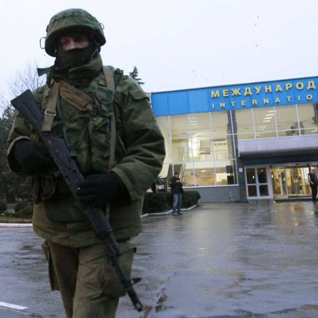 Soldier with assault rifle in front of airport